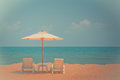 Two beach chairs and white umbrella on the tropical beach Royalty Free Stock Photo
