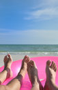 Two beach feet pink ring Royalty Free Stock Photography