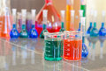 Two beakers filled with chemicals small Stock Photos