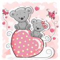 Two Bears is sitting on a heart Royalty Free Stock Photo