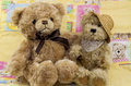 Two bears a view of on a patch worked quilt Royalty Free Stock Images