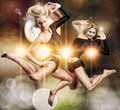 Two beautiful athletic girl jumping Stock Images