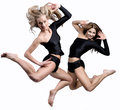Two beautiful athletic girl jumping Stock Image