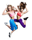 Two beautiful athletic girl jumping Royalty Free Stock Photos