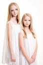 Two Beautiful Blond Teenage Girls Dressed in White. Royalty Free Stock Photo