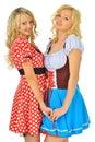 Two beautiful blonde women in carnival costumes