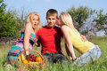 Two beautiful blonde and young man Royalty Free Stock Photos