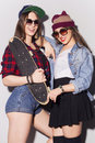 Two beautiful brunette women (girls) teenagers spend time togeth Royalty Free Stock Photo