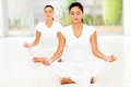 Two beautiful caucasian women meditating indoors Royalty Free Stock Photography