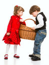 Two beautiful children with basket Stock Photo