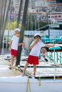 Two beautiful children, boy brothers, standing on a boat, smilin Royalty Free Stock Photo