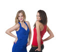 Two beautiful fashion girls young women confidence on the white background Stock Photography