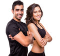 Two beautiful fitness instructors posing over white background Royalty Free Stock Photography