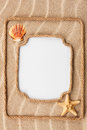 Two beautiful frame made of rope and sea shells with a white bac background on the sand Royalty Free Stock Photo