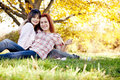 Two beautiful girlfriends at the autumn park Stock Images