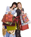 Two beautiful girlfriends enjoy shopping. Royalty Free Stock Photo