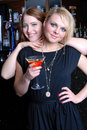 Two beautiful girls in bar Stock Photography