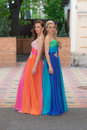 Two beautiful girls in colorful evening dresses Royalty Free Stock Photography