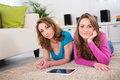 Two beautiful girls having fun at home portrait of relaxed Royalty Free Stock Photography
