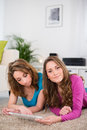 Two beautiful girls having fun at home portrait of relaxed Stock Images