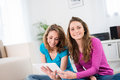 Two beautiful girls having fun at home portrait of relaxed Stock Photos