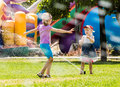 Two beautiful girls having fun outside in the city Royalty Free Stock Photo