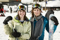 Two beautiful girls holding there skis Royalty Free Stock Photography