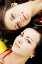 Two beautiful girls  lying on the grass. Stock Photos