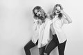 Two beautiful girls in men shirts and jeans Royalty Free Stock Photo