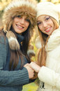 Two beautiful girls outdoor in winter on sunny day Royalty Free Stock Photography
