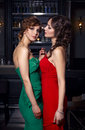Two beautiful girls in the restaurant concept homosexuality Stock Image