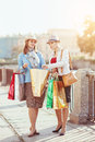 Two beautiful girls with shopping bags in the city Royalty Free Stock Image