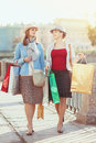Two beautiful girls with shopping bags in the city Royalty Free Stock Photography
