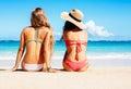 Two Beautiful Girls Sitting on the Beach Royalty Free Stock Photo