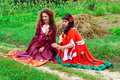 Two beautiful gypsy girls reading cards Stock Photo