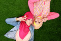 Two beautiful happy muslim woman smiling lying on grass portrait of women Stock Photo