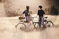 Two beautiful hipsters standing outdoor in summer with white vintage fixed gear bicycle Royalty Free Stock Photos
