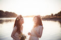 Two beautiful laughing sisters in the rays of sunset Royalty Free Stock Photo