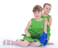 Two beautiful little girl with a bouquet of blue flowers Royalty Free Stock Photo