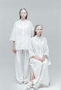 Two beautiful mystical women in white dress Royalty Free Stock Photo