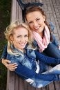 Two beautiful smiling young women Royalty Free Stock Photo