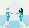 Two beautiful stewardess in blue uniforms inside an airliner passenger cabin Royalty Free Stock Photo