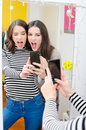 Two beautiful teenage girls taking selfies while making faces Royalty Free Stock Photo
