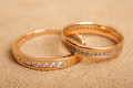 Two beautiful wedding rings with brilliants close up. Marriage concept Royalty Free Stock Photo