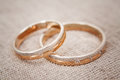 Two beautiful wedding rings with brilliants close up. Selective focus Royalty Free Stock Photo