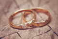 Two beautiful wedding rings with brilliants, vintage toned Royalty Free Stock Photo