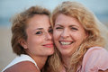 Two beautiful woman best friends on beach having fun girls summer lifestyle Royalty Free Stock Photos