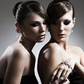 Two beautiful woman with jewelry Stock Image