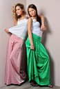 Two beautiful woman posing in a fancy dresses Royalty Free Stock Photo