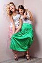 Two beautiful woman posing in a fancy dresses Royalty Free Stock Photography